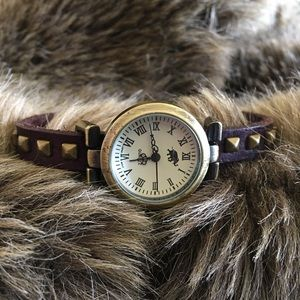 Ladies Elephant brown studded leather band watch